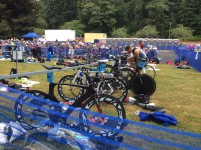 "As the ""masters"" group came in with their bikes and left for the run, there were many very interesting and expensive professional type bikes in the front of the transition area."