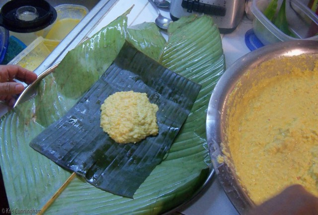 A veehow leaf, a rectangle of plantain leaf, and the tamale filling