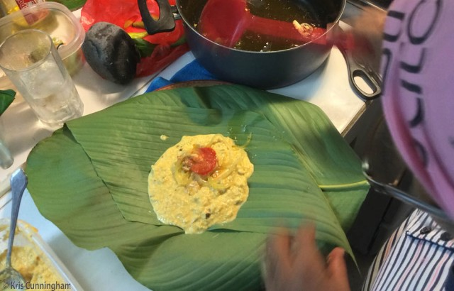 Garnish on top, and ready for folding (this is from the first batch with only bijao leaves)