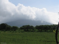 We are off! The volcano is covered with clouds this morning and there are some really green fields.