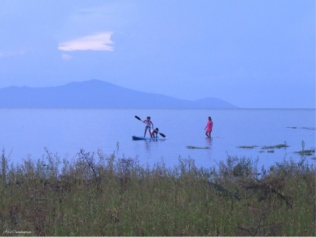 A couple other kids try the paddle board