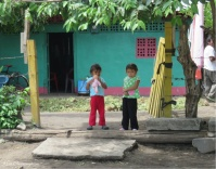 These children playing in front of their house become shy when I talk to them, like many children everywhere.