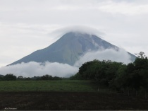 As we walked to town we saw this other beautiful scene with clouds at the base as well as the top of the volcano.