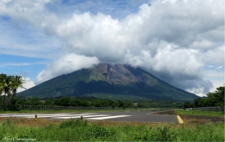 Last but hardly least, we took a walk down the road to the end of the airport runway where there is a beautiful view of the volcano.