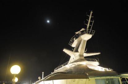 Outside, there was a full moon behind the ship.