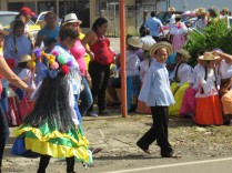 Girls in their beautiful dresses wait for their turn to start down the parade route. There were also a few dressed as mirror devils - https://epiac1216.wordpress.com/2009/11/19/the-mirror-devils-of-panama/
