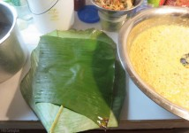 Put a bijao leaf in the pan, and then a plantain leaf on top