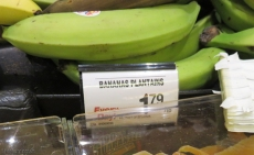 Plantains aren't a usual food item in the US so of course they are more. Here though, there is grumbling if they go up to $.15 each. The sign says these are from Ecuador.