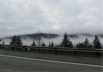 Clouds blanket some of the valleys