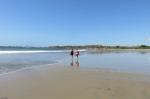 My friends walking on the beach