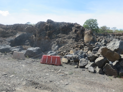 Piles of rock and rubble are waiting to be removed.