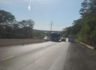 A disabled bus is stopped in the road to make it even more interesting to get through.