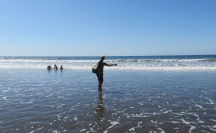 Jeremy gets his feet wet in the Pacific waters.