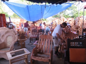 Behind the displays, workers were busy making more furniture and there were piles of items in progress in the back.