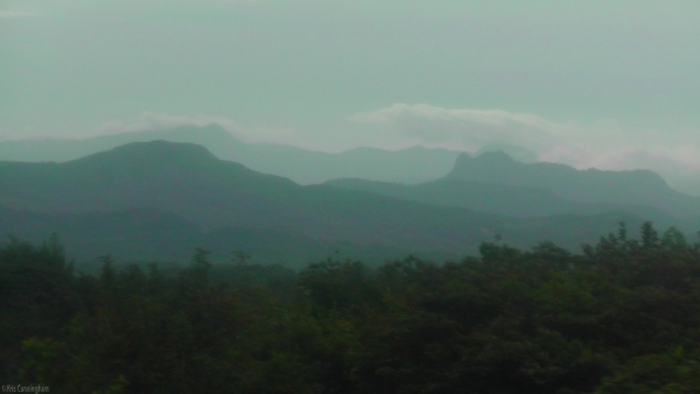 The evening haze blurs the mountains in the distance