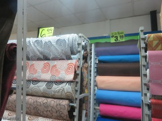 At the back of the store is a section of upholstery fabrics