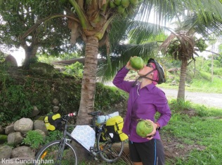 She is good at cutting the tops of coconuts so we can drink the refreshing juice.