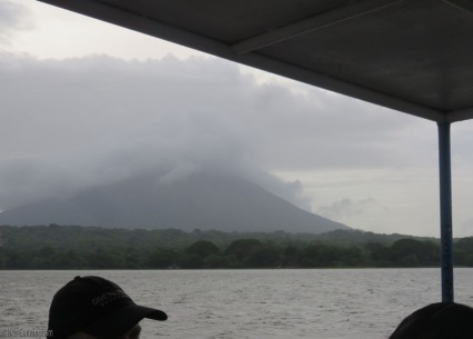 One of the volcanoes of Ometepe recedes in the background as the ferry makes its way back to the mainland.