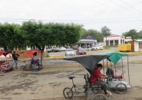 Heading out of Rivas past a few of the many bicycle carts that take people around town.