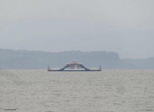 another ferry heads across the water