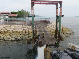 they carefully bring the ferry in to the dock and line it up with the ramp.
