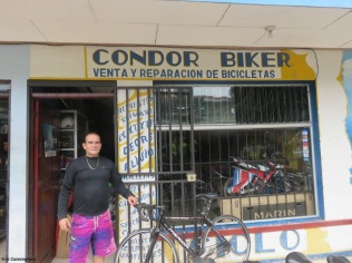 Condor in front of his shop.