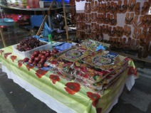 There were many tables and booths selling apples, grapes, and the traditional Christmas bread