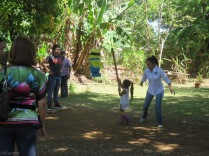 A little girl takes a swing at the piñata