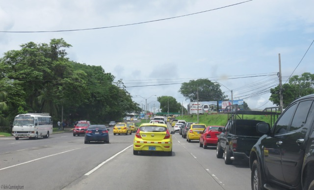 Sitting in traffic for a while. All the yellow vehicles are taxis. Yes, we have a whole lot of taxis here!
