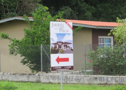 As you leave our neighborhood you see this sign pointing across the street to the new neighborhood under construction.