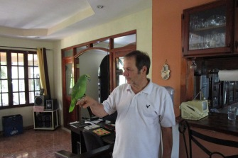 Last but certainly not least, Moty with one of his parrots