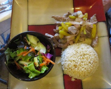 Joel had sauteed beef with onions and peppers, rice and salad. It was very flavorful.
