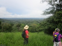 We proceed past the cow pasture to see we are quite high up with a view of a great distance