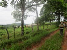 We set off down the very muddy path past the cows, greeting a couple men on horses as we go