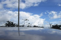 More clouds reflecting off the roof of the car