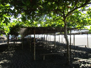At the public beach area they have constructed many shaded areas for people to sit and relax