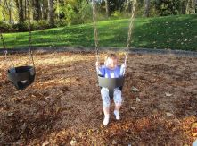 After a while, it seemed like she was catching on to the idea of moving her body to help herself swing.