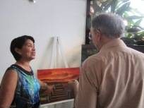 My friend Haydeé discuses a painting with Joel
