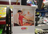 We were waiting our turn at the checkout counter and had some fun with the ad. Look honey, there are air vents in the back of the case! Is he wearing any pants? t always strikes me as odd to see very gringo looking people in Panamanian advertising, but it happens a lot.