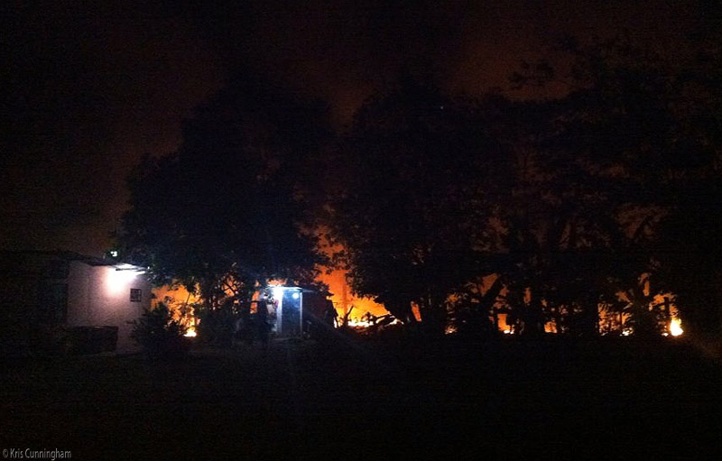 Before long, the fire is close to my neighbor's house and tool shed