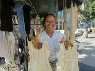 We went back to the boulevard and found two cute dressed for my granddaughter, hand made by this lady
