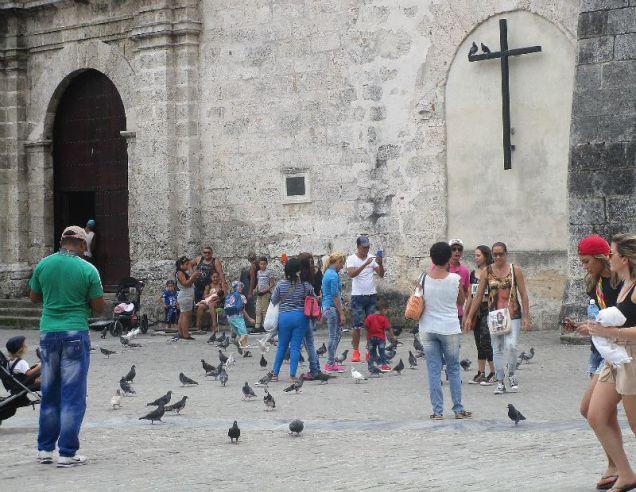 Feeding pigeons outside the Basílica San Francisco de Asis
