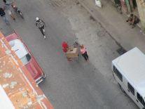 A street vendor makes a sale