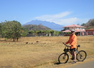 Joel stops in front of the view of Volcan Baru