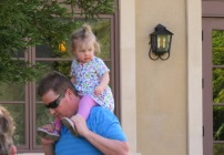 Then she enjoys a ride on Dad's shoulders