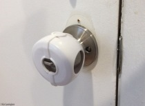 This one is easier. Stick your fingers through the holes to grasp the doorknob.