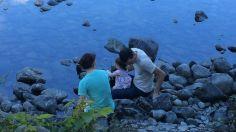 Looking at fish and interesting rocks