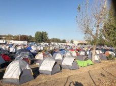 Firemen, police, national guard and other helpers camped out at the fairgrounds