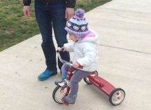 If you get her started she can pedal the tricycle on her own
