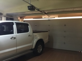 The 2 car garage is immaculate with tile floors and storage space for all your tools.